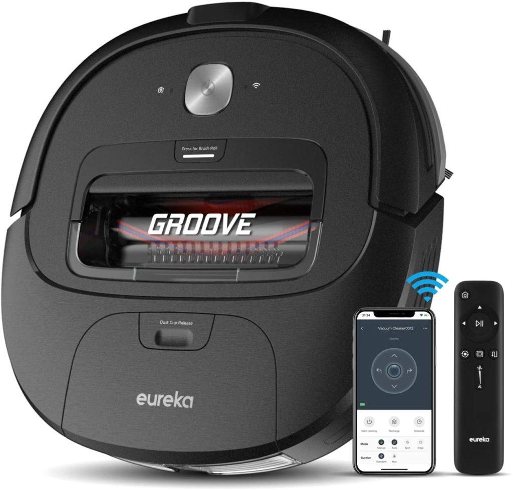 Eureka robotic vacuum with remote controls.