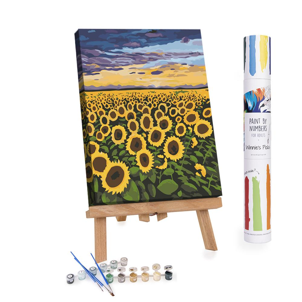 Materials needed next to an easel with painted sunflowers.