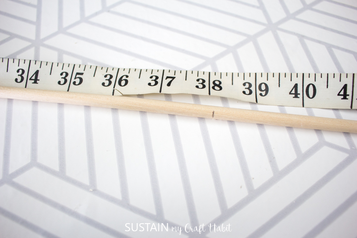 Measuring the length of the wooden dowel.