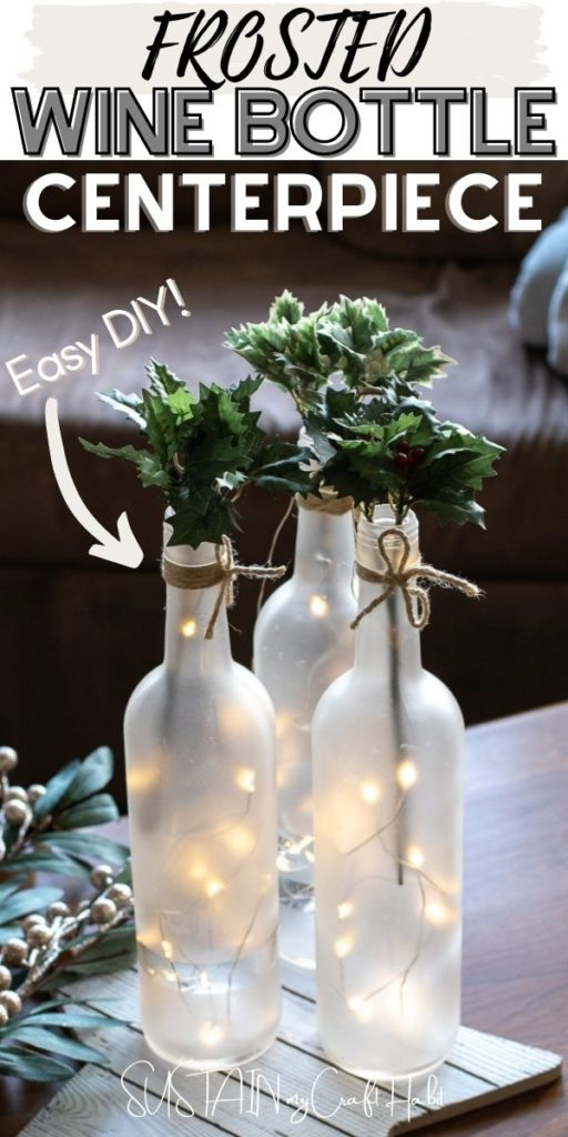 Frosted wine bottle centerpieces arranged with twinkle lights and fresh greenery including text overlay.