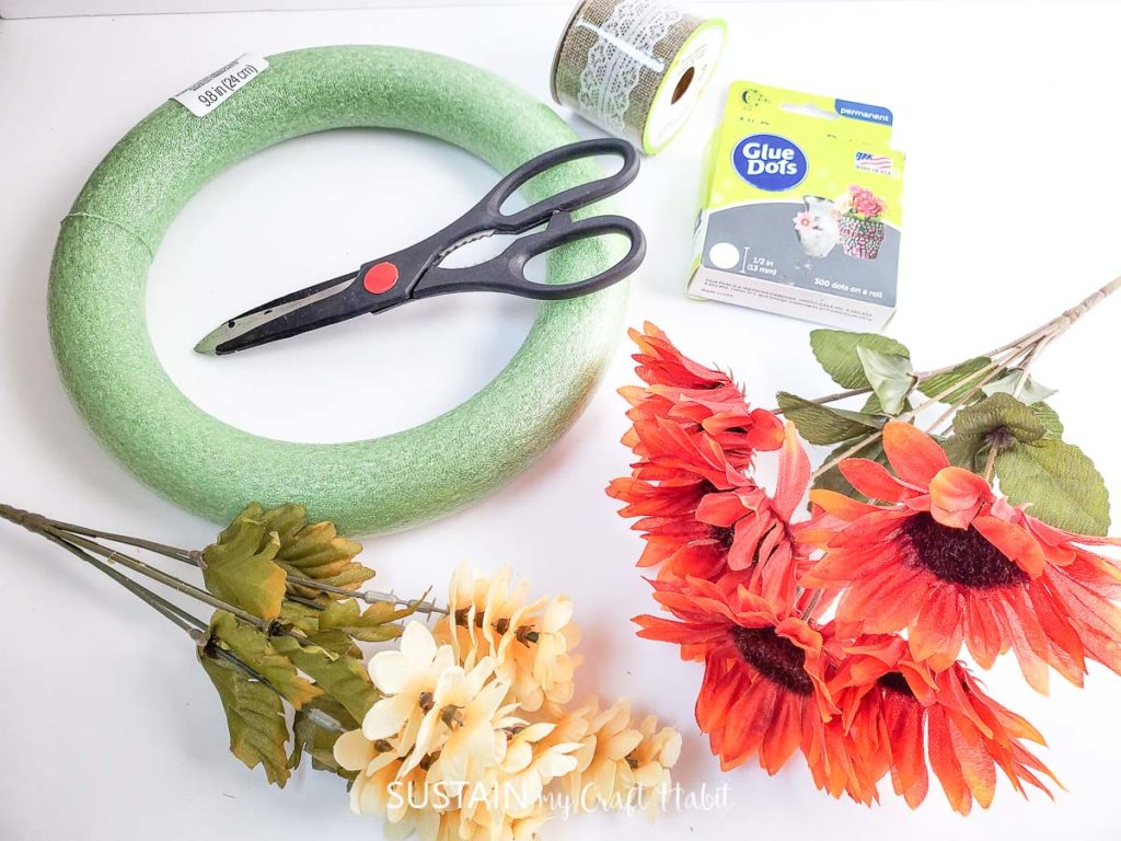 Materials needed to make a dollar store fall wreath.