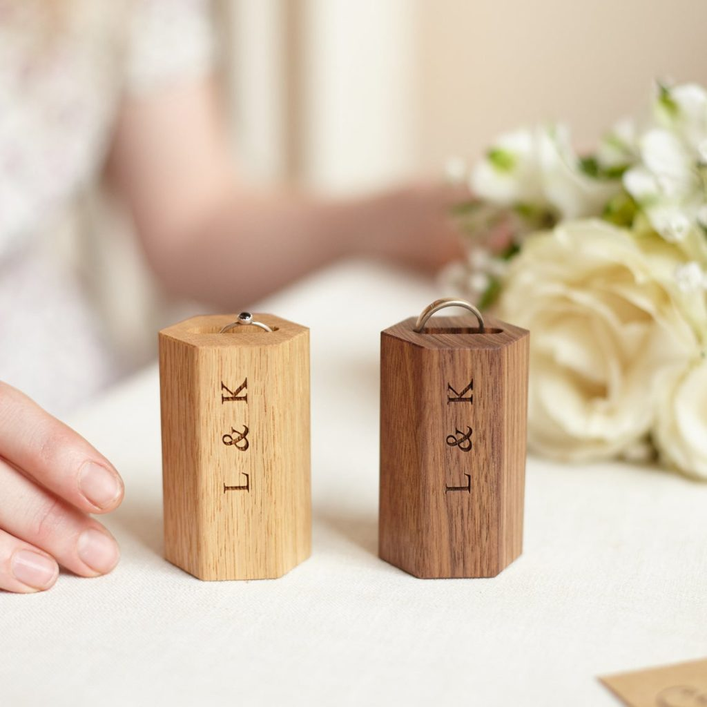 Engraved wooden ring holders.