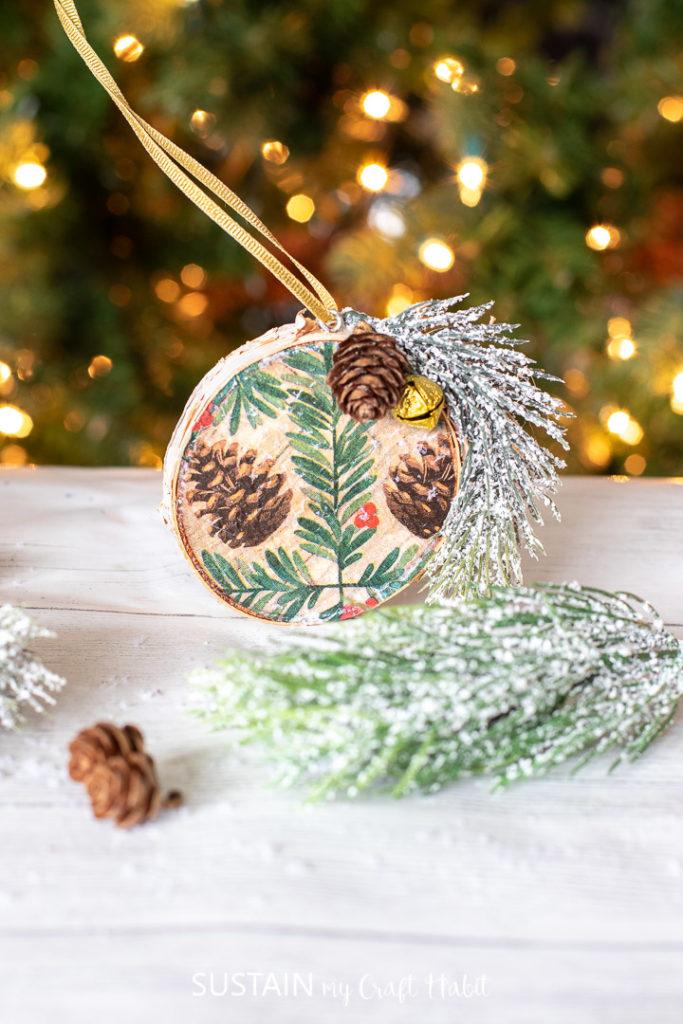 Repurposed paper napkin wood slice ornament.