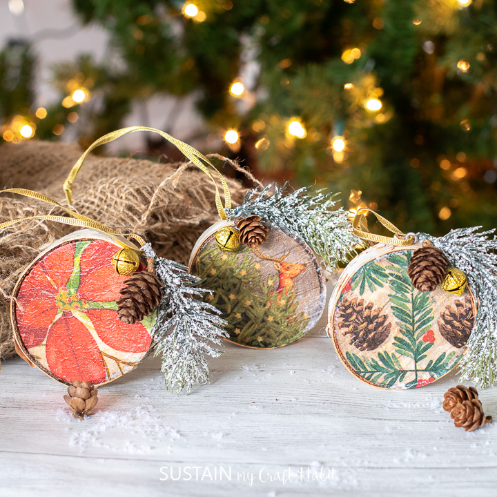 set of three wood slice ornaments with paper napkin mod podged over top.