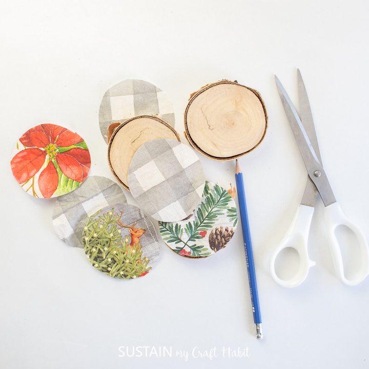 Tracing the napkins around the wood slices and cutting out the napkins.