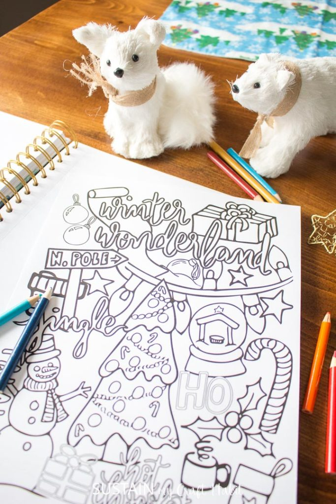 Winter coloring page with pencil crayons and toys.