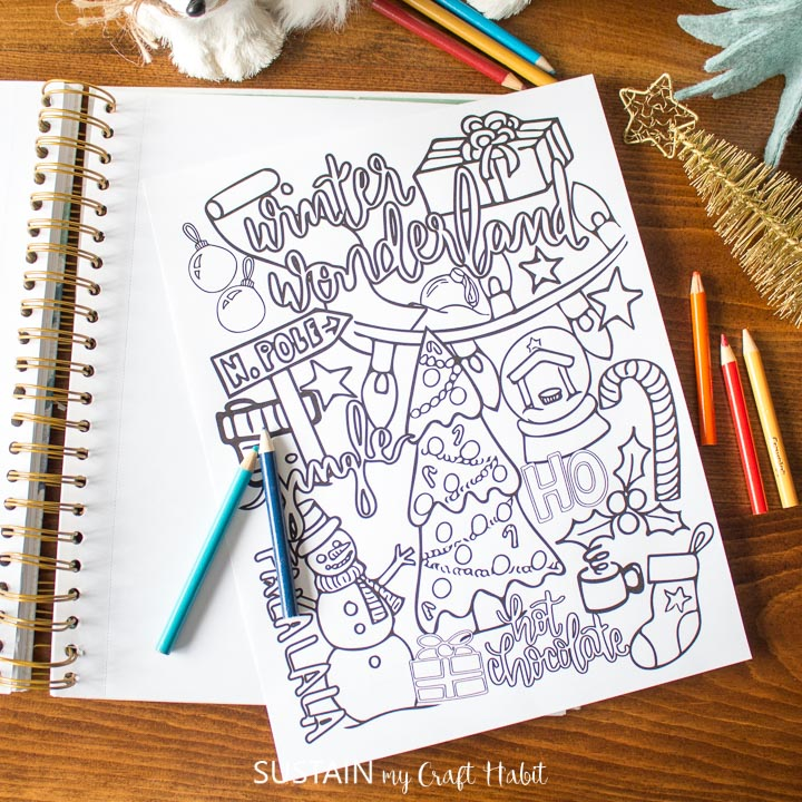 Winter coloring page on a notebook.
