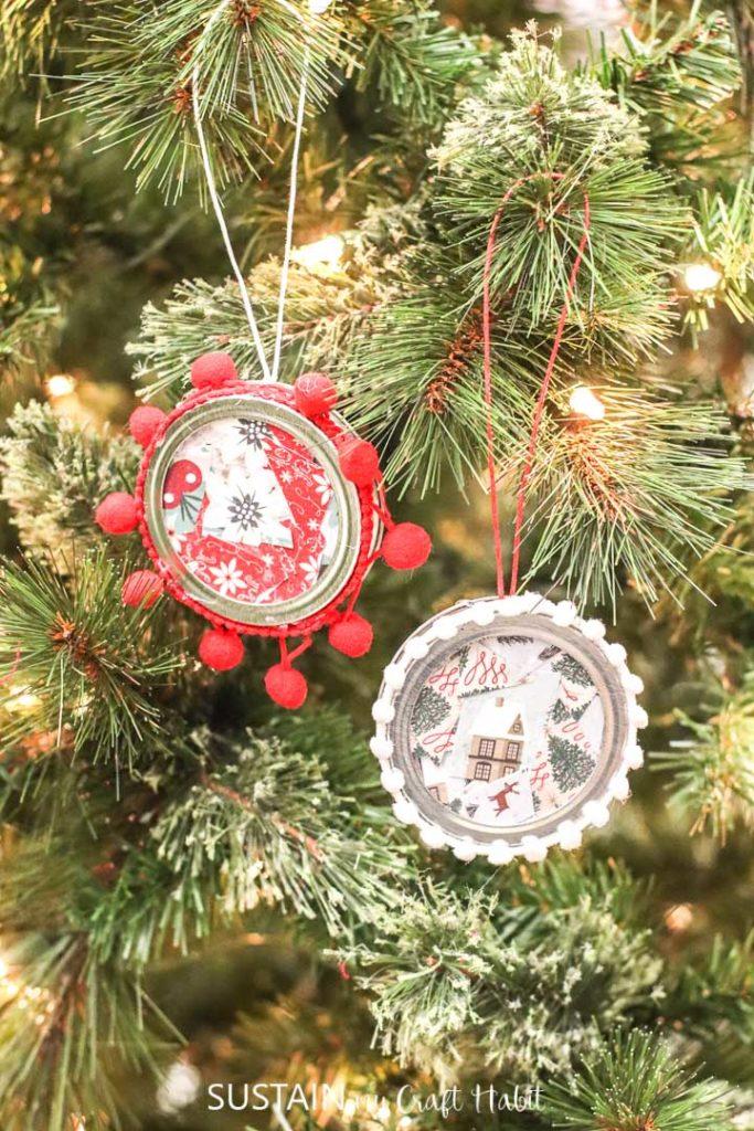 Canning jar lid ornaments hanging from a tree.