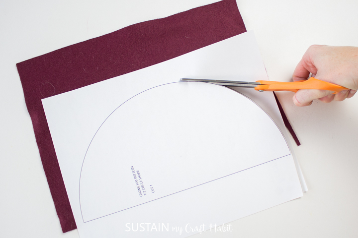 Cutting the felt sheets around the printable pattern.