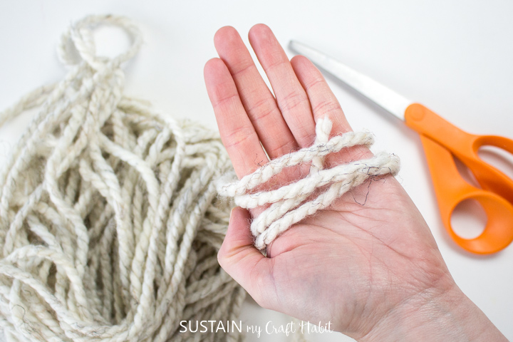 Wrapping yarn around the palm of a hand.