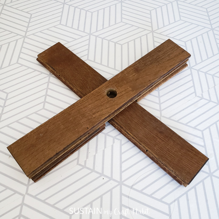 """Stacking wood boards to make an """"X"""" shape."""