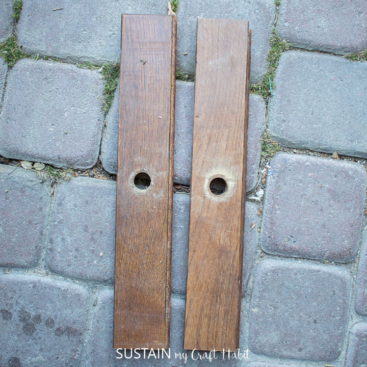 Two wood boards with holes in the middle.