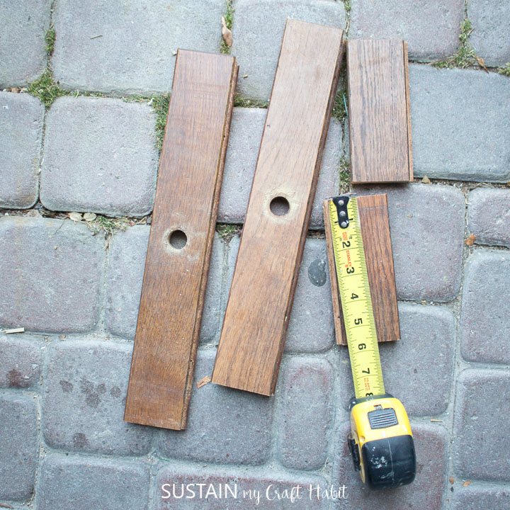 Measuring wood boards.