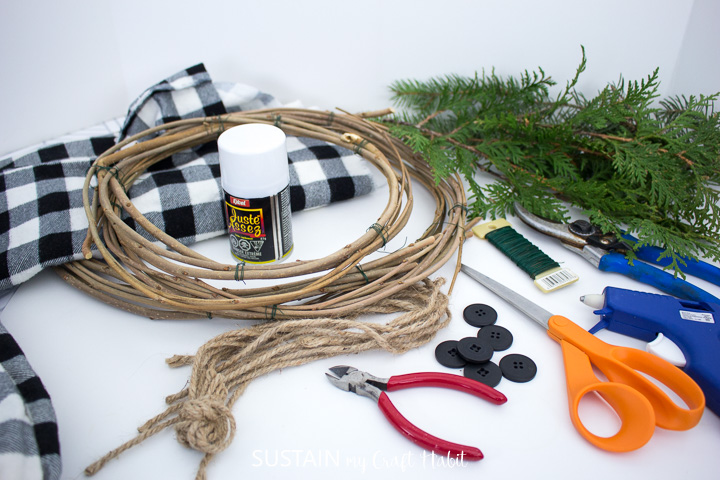 Materials needed to make a snowman wreath.