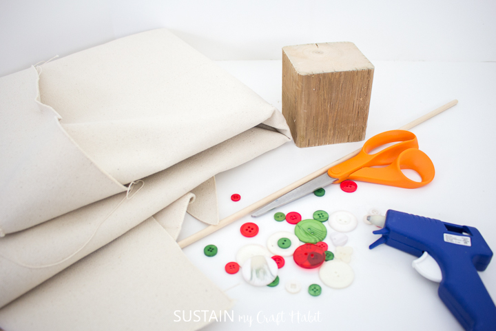 Materials needed to make a no-sew canvas Christmas tree.
