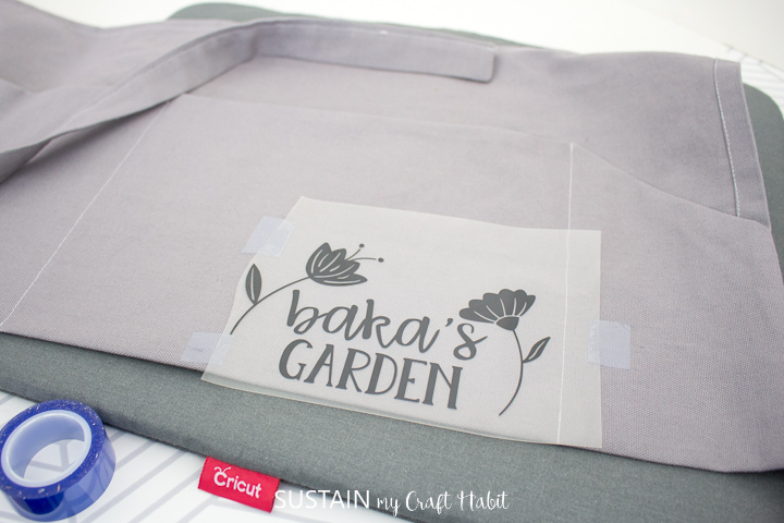 place the image on to the apron and tape in place using Cricut heat resistant tape
