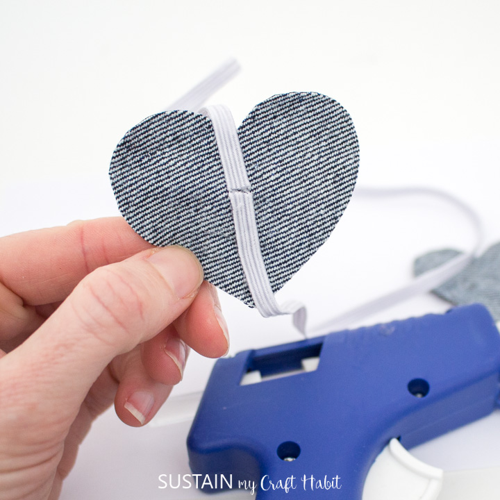 Gluing elastic to the back of the denim heart.