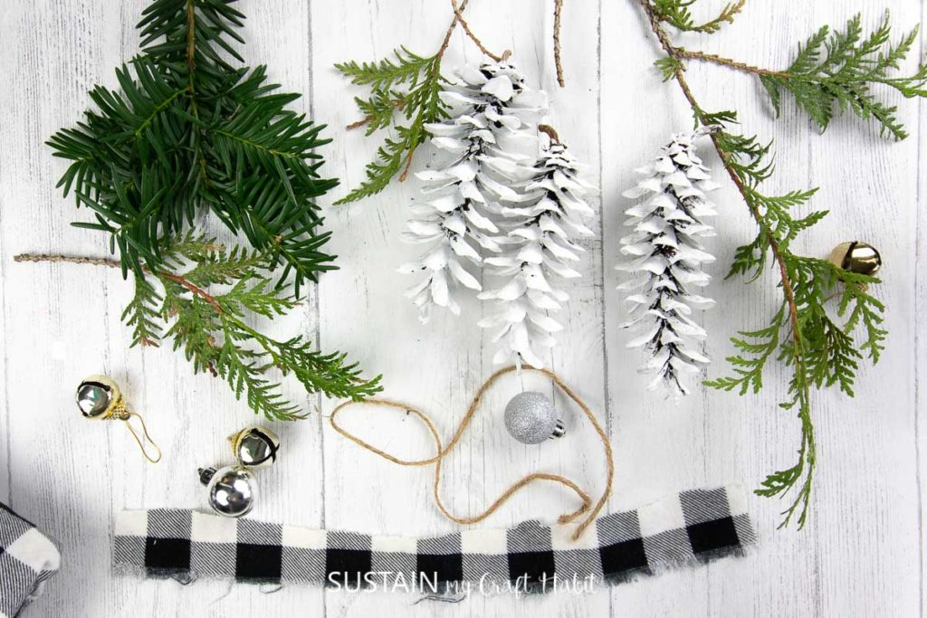 supplies needed to make pretty painted pine cone ornaments for Christmas