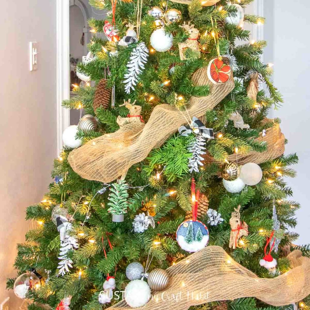decorated Christmas tree with a bunch of painted pine cone ornaments