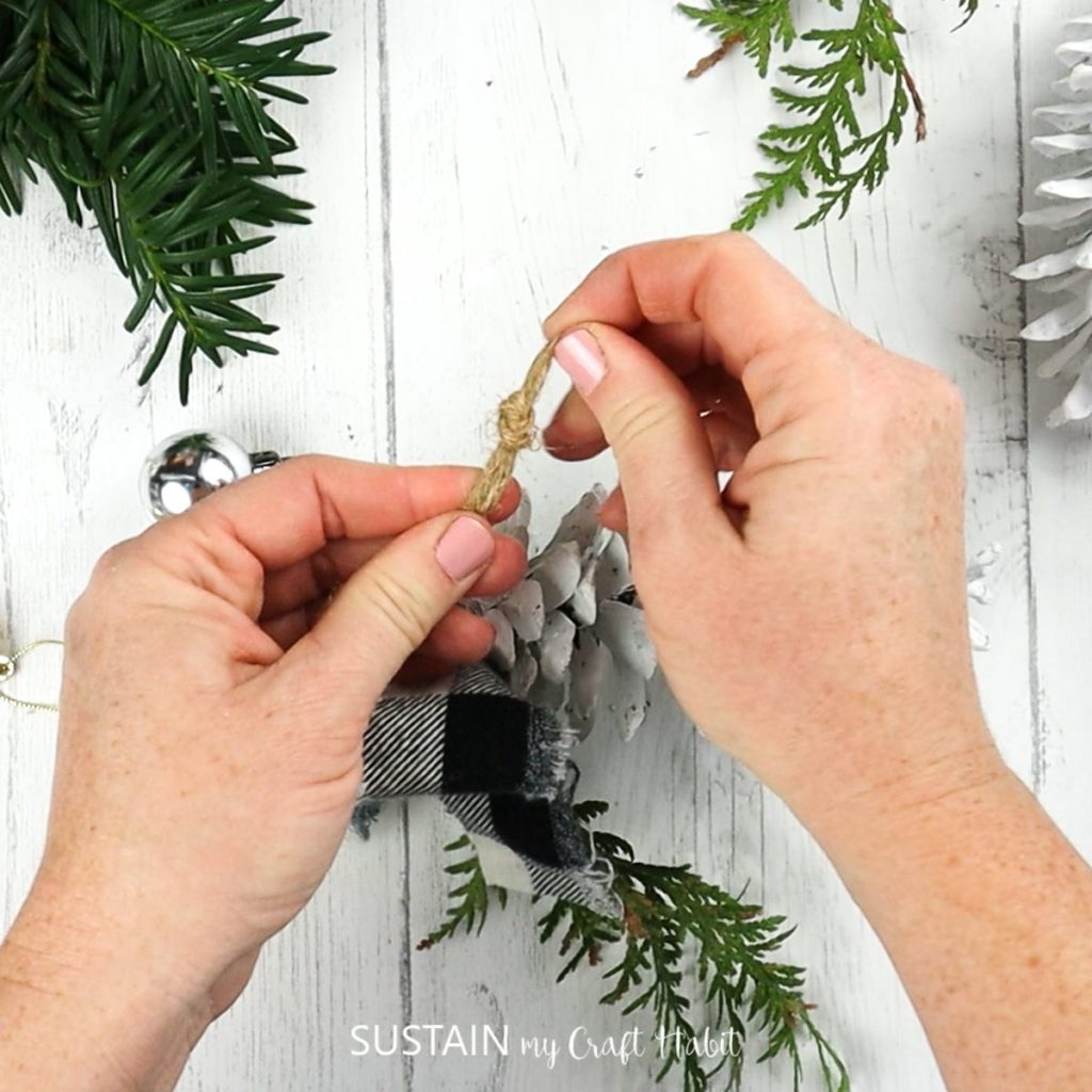 tieing a knot for the hanging loop