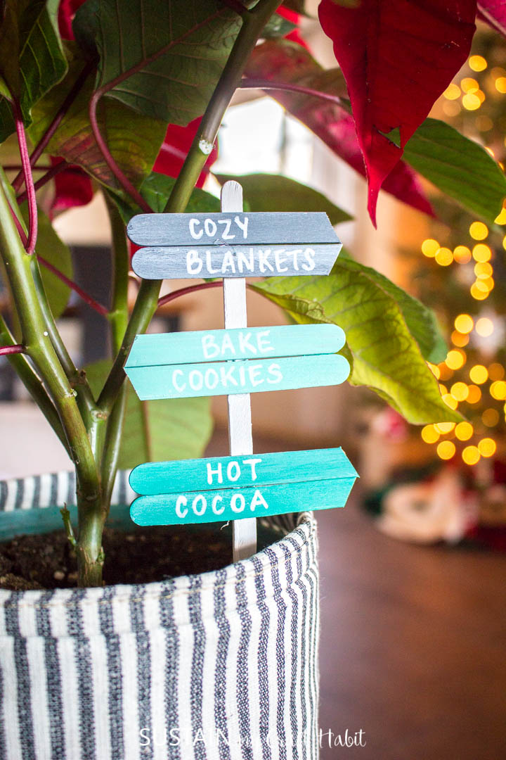 Popsicle stick plant picks inserted into a canvas planter.