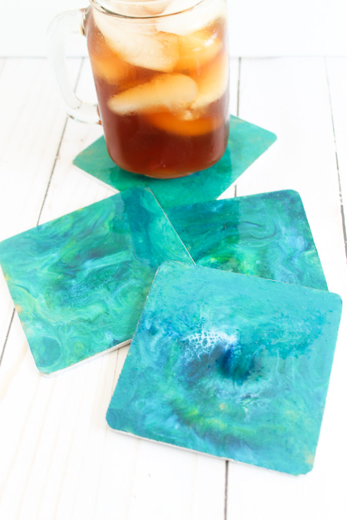 Resin crafts coasters with a drink.