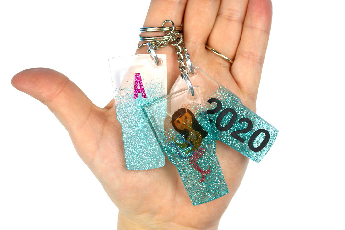 Resin crafts holding keychains.