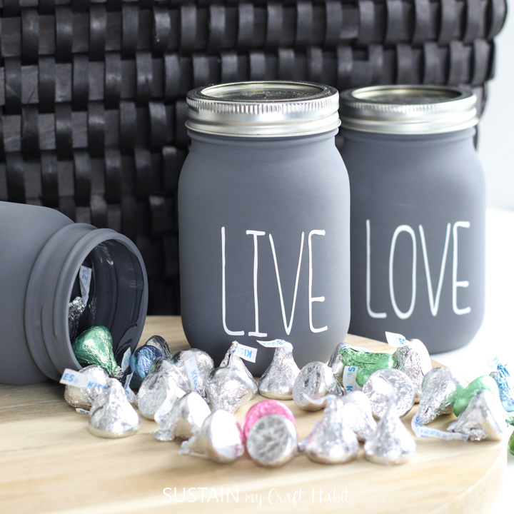 chalky painted jars on a table with hershey kisses spilling out