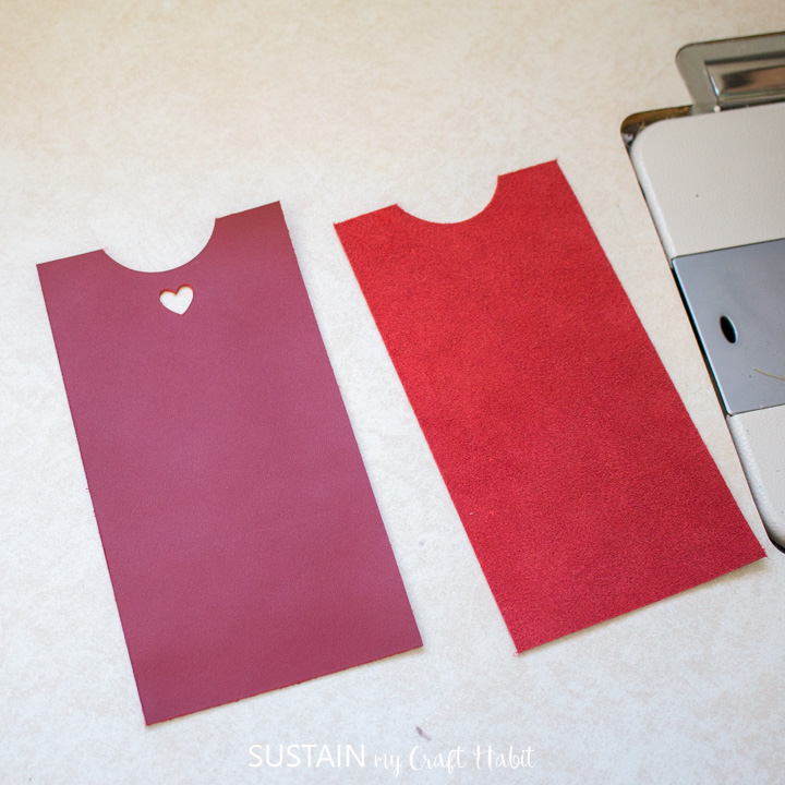Placing the red leather sleeves next to each other.