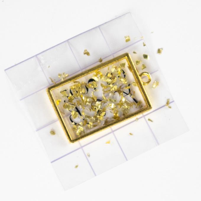sprinkle gold flecks over top of the prepared bezel