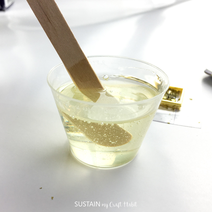 Mixing resin and hardener in a plastic cup.