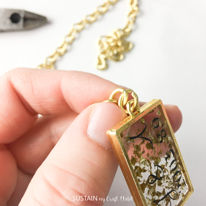 Attaching the keychain to the gold bezel.