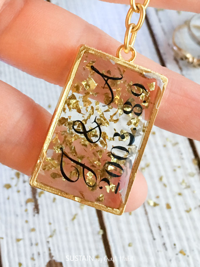 Holding a Resin keychain with gold flakes.