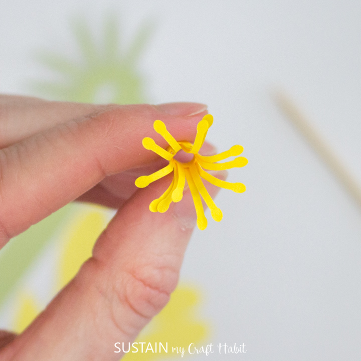 Curling the outer edge of the pistol paper flower.