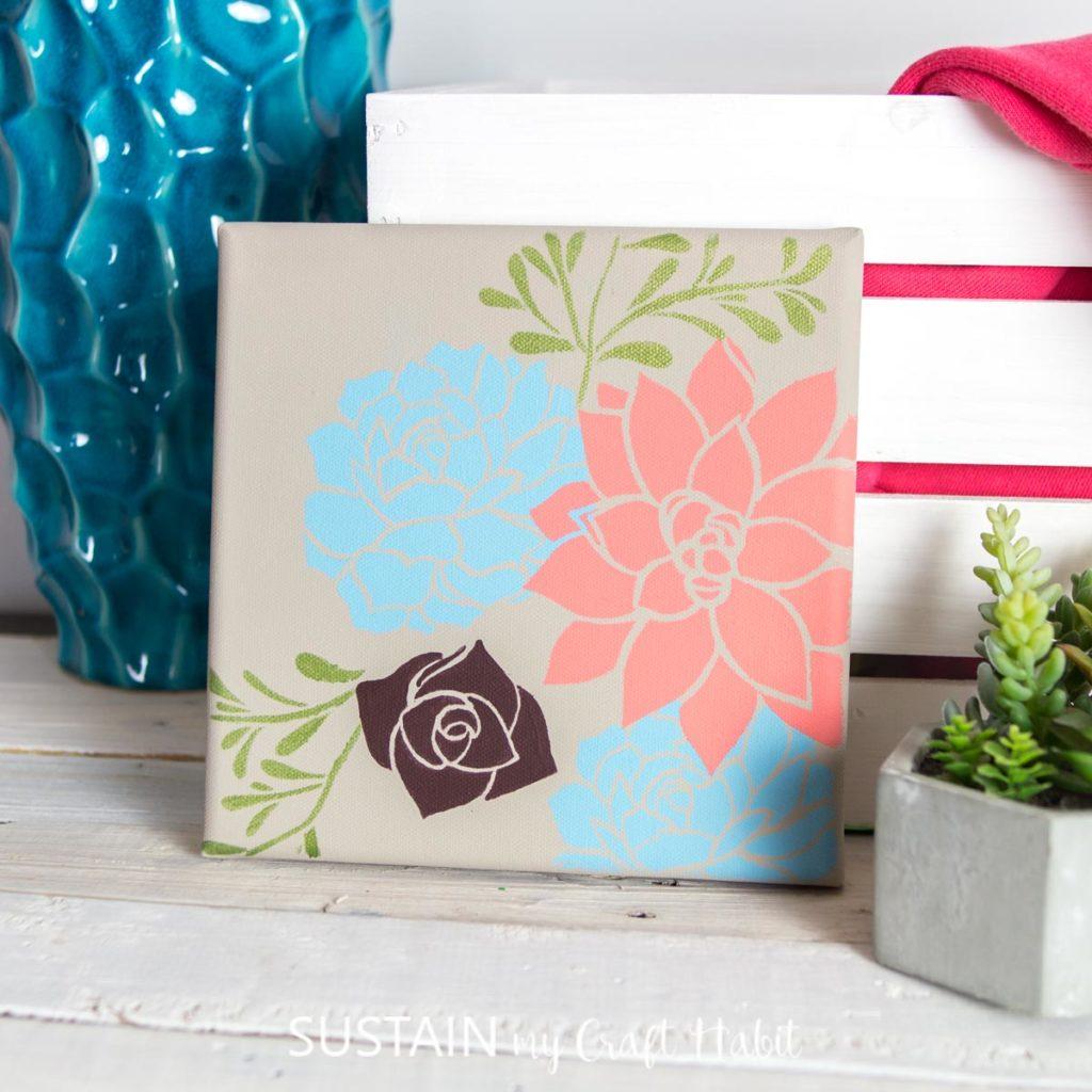diy stencil art on canvas with a pretty succulent stencil