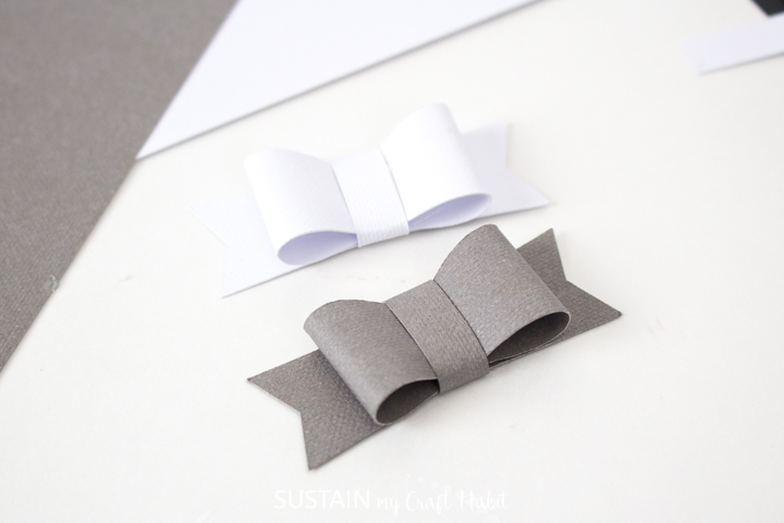 White and grey paper bows.