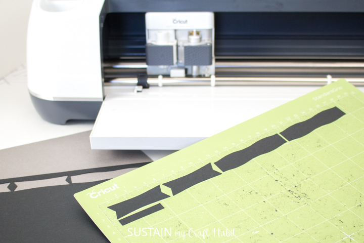Removing the cut bows from the Cricut grip mat.
