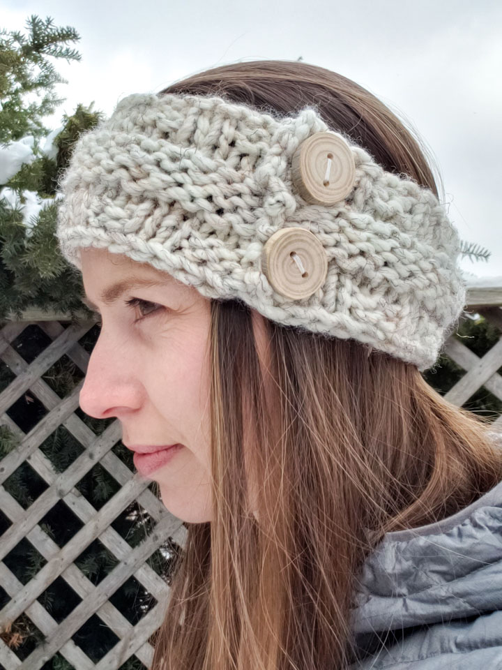 A woman wearing a knitted headband.