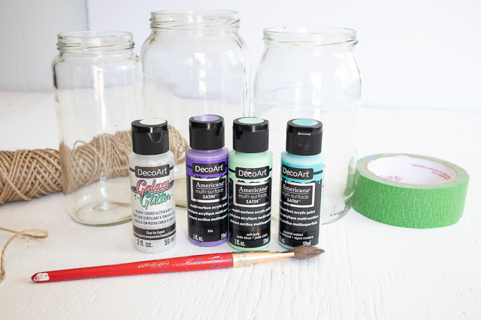 Materials needed to make centerpieces including mason jars, paint and tape.