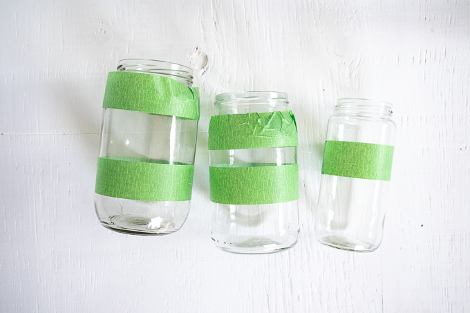 Painters tape added to the circumference of glass mason jars.