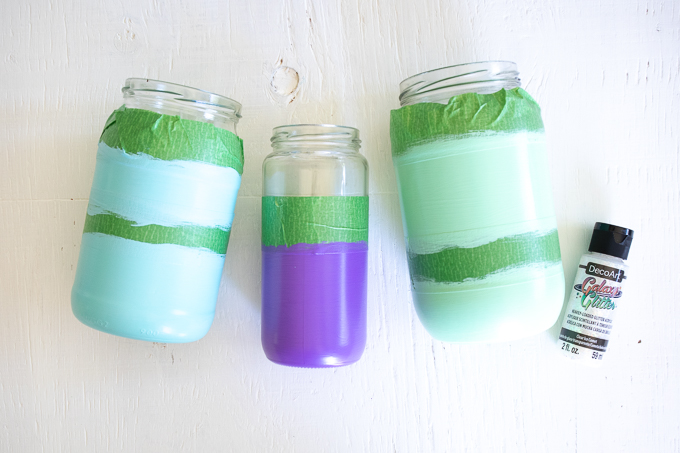 Painted mason jars with green tape.