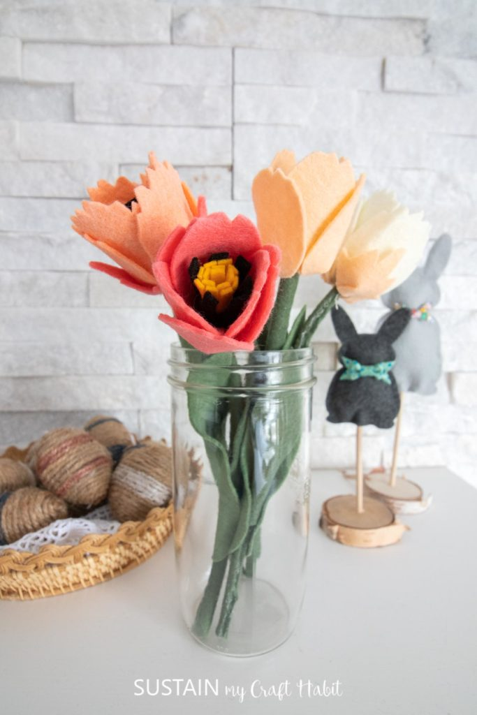 Felt tulips in a glass jar.