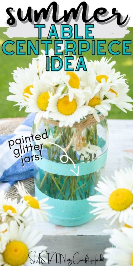 Mason jar summer table centerpiece with daisies and text overlay.