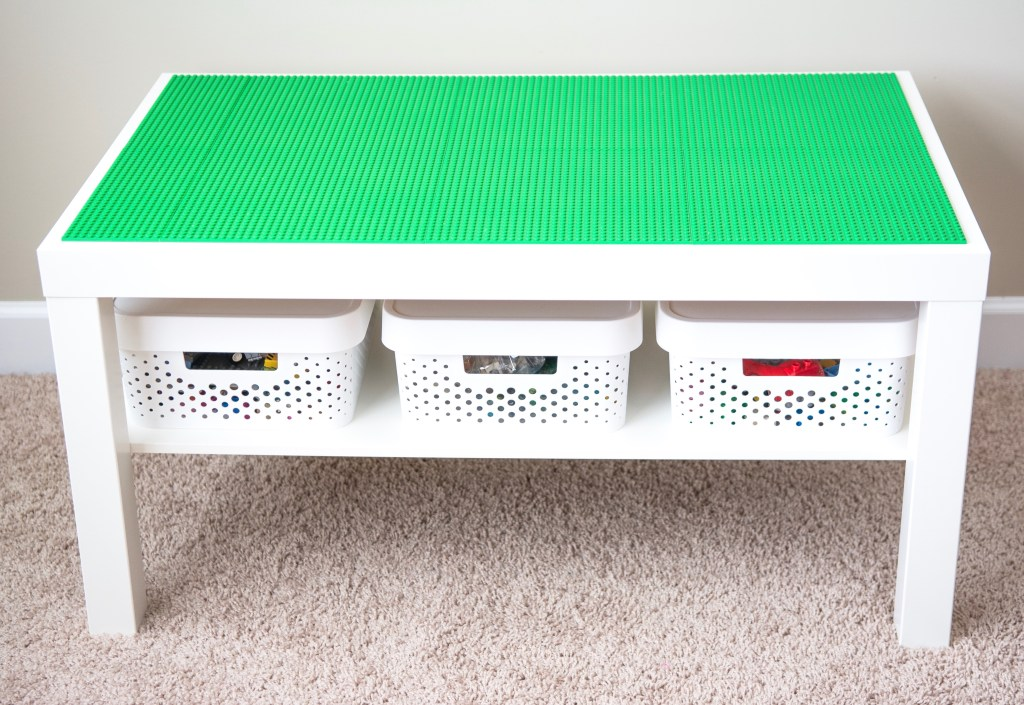 Lego table with white baskets.