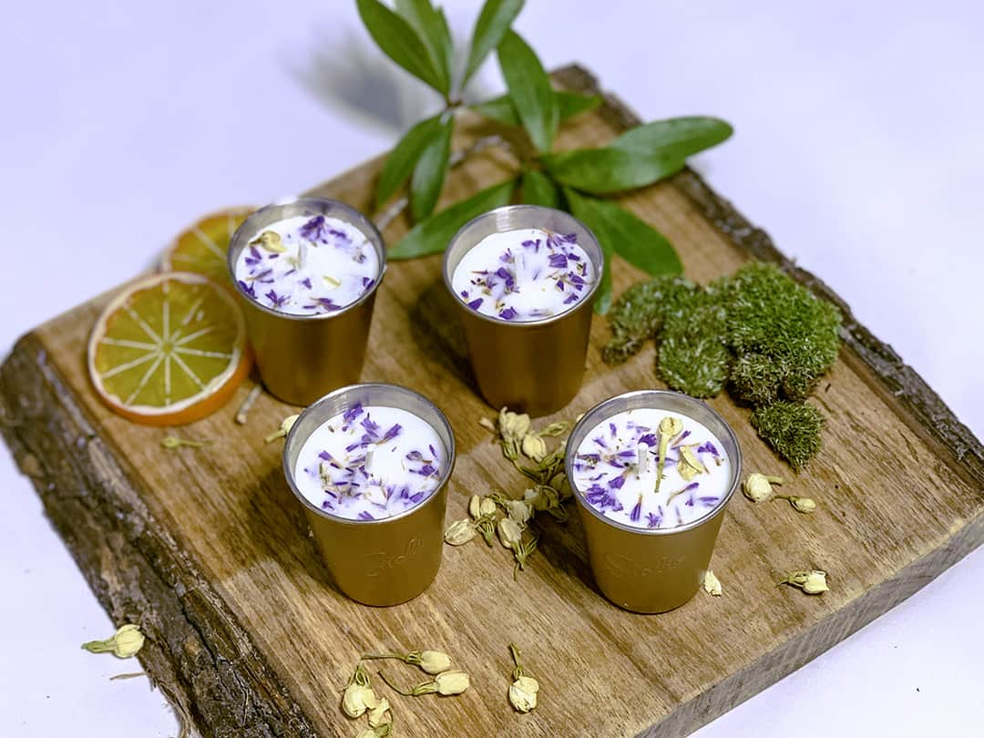 lavender craft candles on a tray.