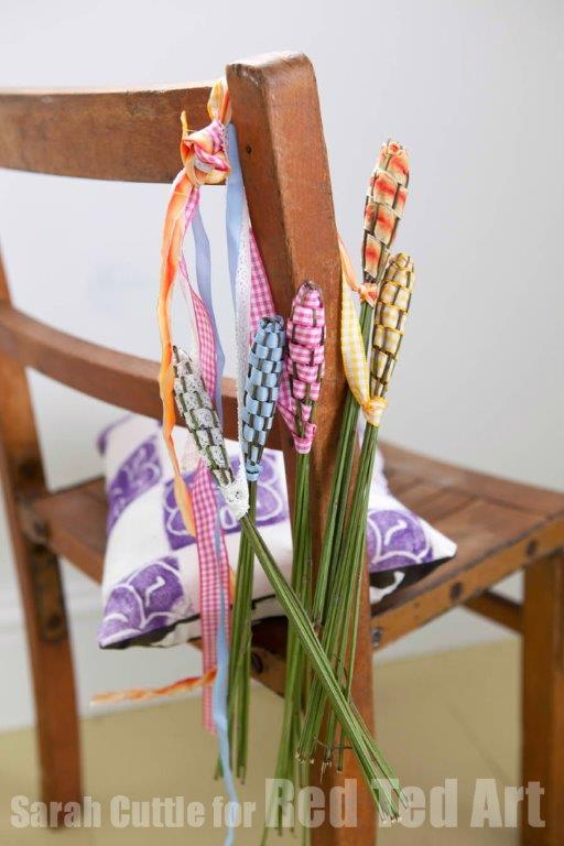 lavender craft wands on a wooden chair.