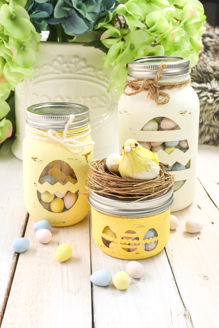 Easter candy jars made from mason jars and decorative twine and birds nest.