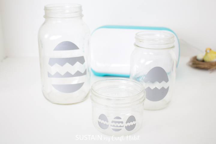 Vinyl Easter egg cut outs placed onto mason jars.