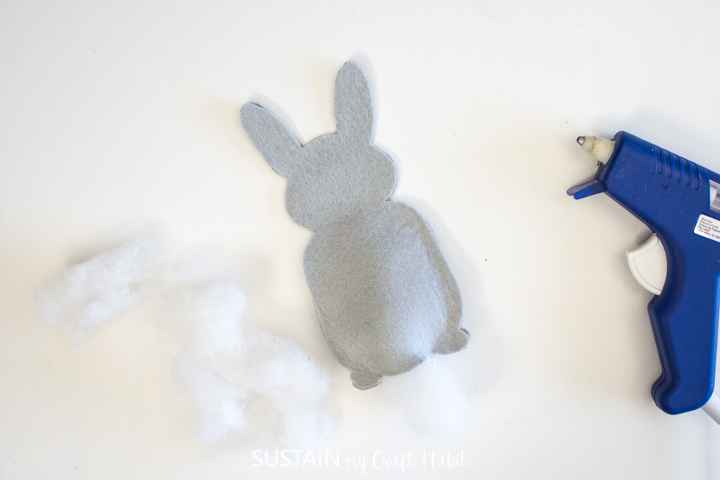 Filling the felt bunny with batting.