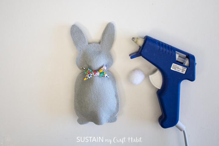 Gluing a bow tie onto a felt bunny.
